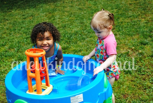 The fun of a water table & being cousins